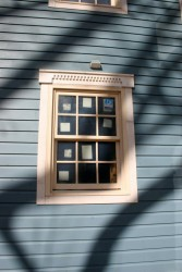 We replicated the existing dentil-style window head trim at the heads of our modern, energy efficient windows.