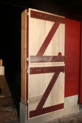 """We construct and install new forebay wall doors to match the original """"Dutch"""" style doors."""
