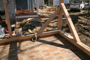 In addition to raising the frame on a higher foundation, we also substitute a new first floor of brick pavers in place of the wood floor lying on dirt.