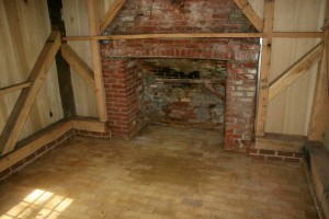 Finished floor of paver bricks continues unbroken throughout the hearth.