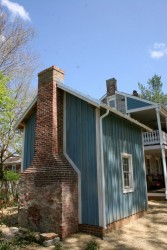 Siding trimmed and flashed around the chimney for a water-tight installation.