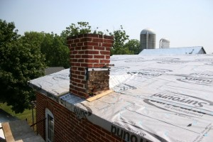 Now half of the rainwater coming off both the main house roof and the ell will divert to the west, rather than all dumping toward the east and the flashing trouble spots.
