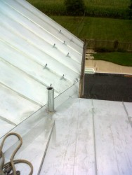With all the pans installed, snow-guards are added to keep large accumulations of snow from sliding down the pans and damaging the gutters.