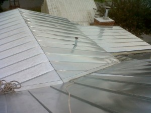 Instead of a rubber membrane on a flat roof holding water, we now have a beautiful standing seam roof that sheds as it should.