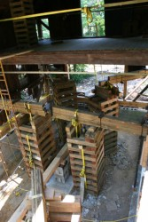 """Six cribbing stacks anchor one end of our """"needle beams"""" which carry the building loads temporarily."""