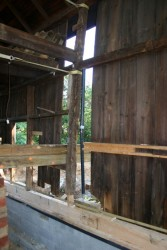 """As we continue to square up and plumb the barn frame it becomes apparent that previous """"repairs"""" have allowed the building to assume quite a bit of deflection."""
