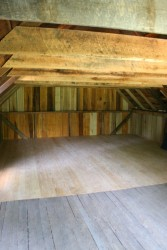 The second floor, re-sided and with reproduced matching flooring installed.