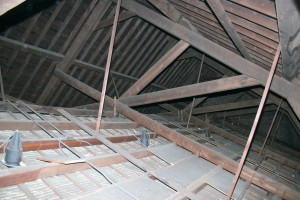 """The large main trusses hold up the slate roof and the decorative vaulted plaster ceiling.  The large (8""""x12"""") oak timbers are still doing a great job after 150 years of service, but need a little maintenance to ensure they keep up the good work for another century and a half."""