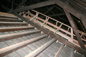 """The original ceiling rafters were surprisingly poorly assembled, with odd splices left carrying too much weight without proper support.  Modern lumber """"sisters"""" help stabilize things and also carry our new walks."""