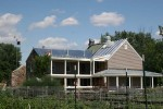 Wrap around porches, second story balcony and new galvanized, standing seam metal roof.